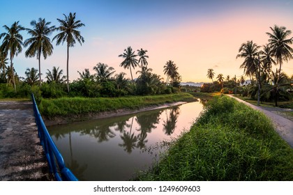 Village river reflection of sunrise view in Balik Pulau, Penang