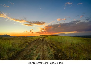 Village road with beautiful sunset