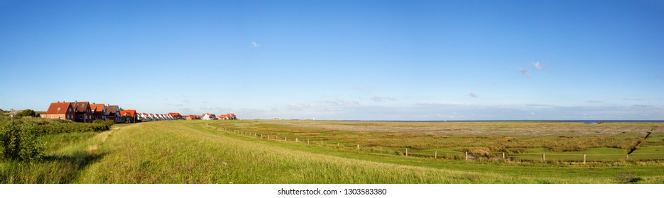 Village and salt marshes at the wadden sea on the north sea island Juist in East Frisia, Germany, Europe.