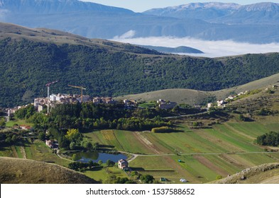 The village of Santo Stefano di Sessanio with cranes that work to rebuild the town from the post-earthquake and its small lake. L'Aquila, Abruzzo, Italy
