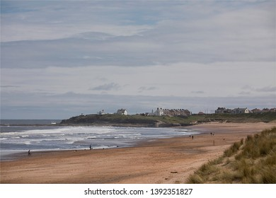 The village of Seaton Sluice in Northumberland on the North East coast of England, pictured looking south from the sand dunes