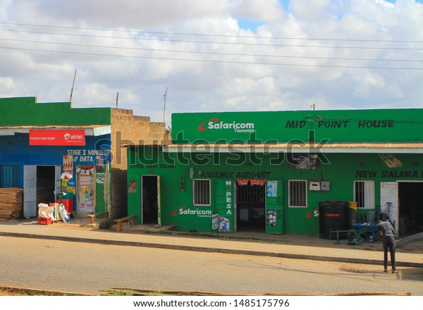"""Village street, Kenya, East Africa. February 2019, Phone shop """"Airtel"""" and """"Safaricom"""", internet access and services. Travel by road through Kenya"""