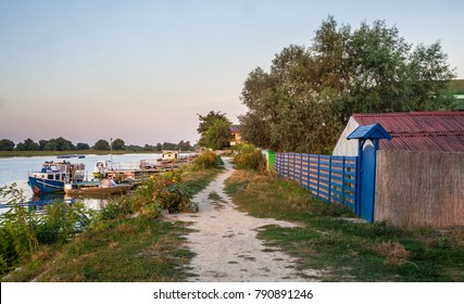 Village street near the Danube Delta canal in Mila 23, Romania