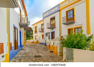 Village street with residential buildings in the town of Bordeira near Carrapateira, Municipality of Aljezur, District of Faro, Algarve Portugal