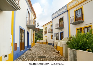 Village street with residential buildings in the town of Bordeira near Carrapateira, in the municipality of Aljezur in the District of Faro, Algarve Portugal