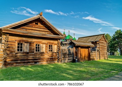 """Village Street in the summer. Wooden log huts in the Siberian village. Ethnographic Open-Air Museum """"Taltsy"""". Wooden architecture Russia. Lake Baikal, Russia"""