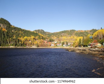 Village surrounded by autumn colours in Saguenay, Quebec, Canada