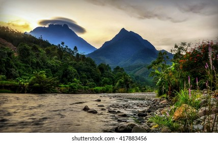 The Village Of Tambatuon, Kota Belud, Borneo, Sabah, Malaysia with Kinabalu Mountain as background and amazing rare cloud formation on the top of it.