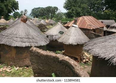 A village of thatched roof huts is typical of Taneka architecture in Benin AFrica