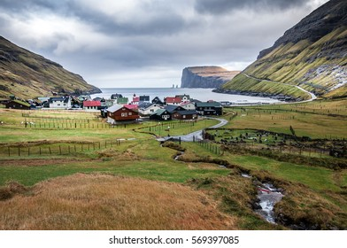 Village Tjornuvik with bay and cliffs, Faroes Islands