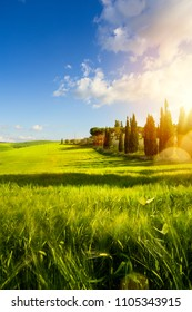 village in tuscany; Italy countryside landscape with Tuscany rolling hills ; sunset over the farm land