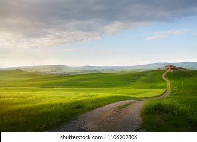 village in tuscany; Italy countryside landscape with Tuscany rolling hills ; sunset over the farm land and country road