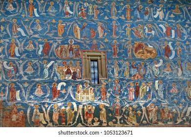 Village Voronet, Romania, 05/01/2016. Frescos on the exterior of the monastery walls