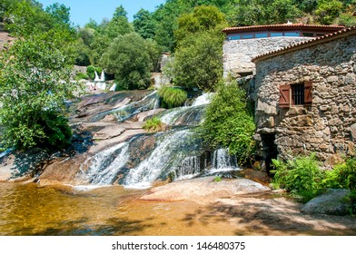 village with waterfall