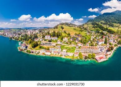 Village Weggis, lake Lucerne (Vierwaldstatersee), Rigi mountain and Swiss Alps in the background near famous Lucerne city, Switzerland