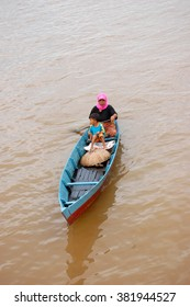 Village woman and her son go to their home with traditonal boat at Lok Baintan, South Borneo, Indonesia. This photo was taken on 27 December 2008.