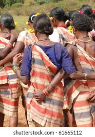 Village women link arms for Gdaba harvest dance in Lamptaput, Orissa, India