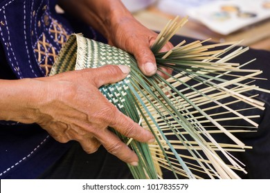 The villagers took bamboo stripes to weave into different forms for daily use utensils of the community people in Bangkok Thailand, Thai handmade product.
