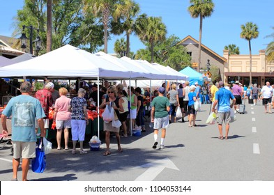 The Villages, FL, USA -April 1, 2017: People shop from various market sellers. Many people buy at Farmer's Market shops near Paddock Square. Shoppers enjoy one of the Farmer's Market in The Villages