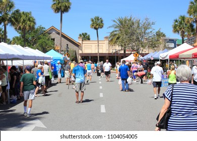 The Villages, FL, USA -April 1, 2017: Farmer's market near Paddock Square. People shop from various Farmer's Market sellers outdoors. Many mature people peruse various shops at outside street market