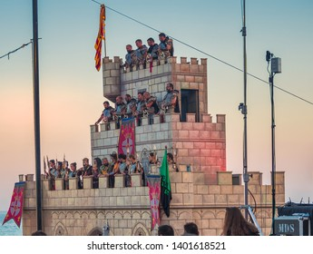 Villajoyosa, Alicante, Spain, July 27, 2018. Representation of the festivities of the Moors and Christians, on the beach of Villajoyosa Alicante. People disguised of the time, inside a castle.