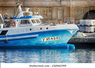 VILLAJOYOSA, SPAIN – FEBRUARY 21, 2019. Trawler fishing boats docked after a journey of fishing in the port of Villajoyosa in the Spanish Mediterranean Sea.