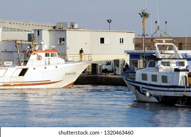VILLAJOYOSA, SPAIN – FEBRUARY 21, 2019. Arrival of Trawler fishing boats fleet of Villajoyosa base in the Mediterranean Sea in Spain.