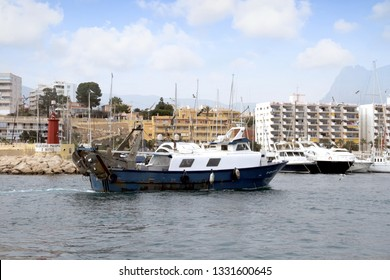 VILLAJOYOSA, SPAIN – MARCH 06, 2019. Arrival of trawler fishing boats after a journey fishing along the coast of Alicante province in the Spanish Mediterranean Sea.