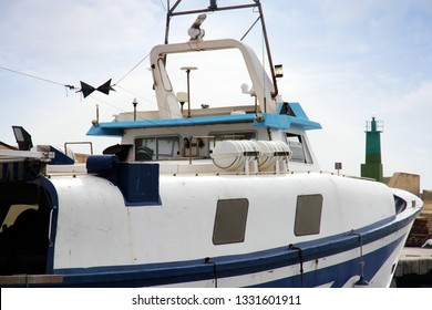 VILLAJOYOSA, SPAIN – MARCH 06, 2019. Trawler fishing boats docked after a journey of fishing in the port of Villajoyosa in the Spanish Mediterranean Sea.