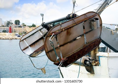 VILLAJOYOSA, SPAIN – MARCH 06, 2019. Steel doors in the stern of a trawler moored in the fishing port of Villajoyosa in Spain..
