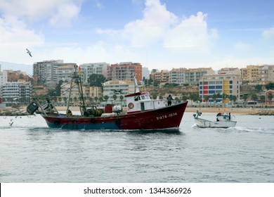 VILLAJOYOSA, SPAIN – MARCH 07, 2019. Arrival of trawler fishing boats after a journey fishing along the coast of Alicante province in the Spanish Mediterranean Sea.