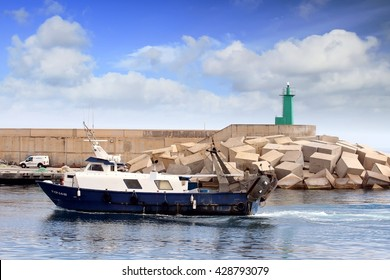 VILLAJOYOSA, SPAIN - MAY 14: Trawler fishing boat entering in the port of La Vila for sale his captures, on may 14, 2016 in Alicante.