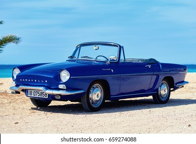 Villajoyosa, Spain - May 28, 2017: Renault Caravelle or Renault Floride car on the tropical beach. It is a sports car which was produced by the French manufacturer Renault between 1958 and 1968