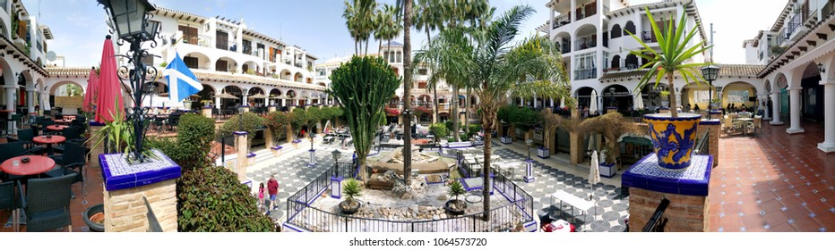 Villamartin, Spain - April 7, 2018: Panoramic view of Villamartin Plaza. Villamartin Plaza lined with a bars and restaurants. Beautifully landscaped gardens and fountains. Costa Blanca. Spain