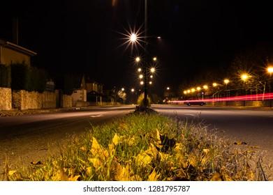 Villamayor, Salamanca (Spain). Janury of 2019. Night view of the urbanization Vega de Salamanca. The wakes of the cars are seen circulating along the Avenue.
