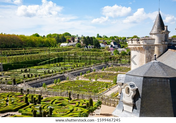 Villandry, France - April 20, 2014: Castle and gardens of Villandry. View of part of the castle and the garden of the park.