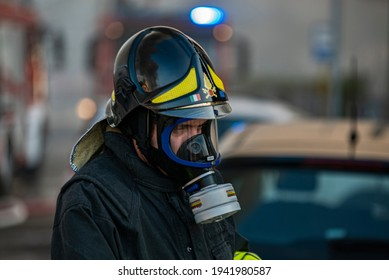 VILLANOVA DEL GHEBBO, ITALY 23 MARCH 2021: Close up of Firefighter with gas mask during emergency work
