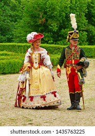 Villarceaux, France - june 9 2019 : fist Empire hussar and a woman in the historical castle park