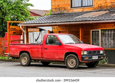 VILLARRICA, CHILE - NOVEMBER 20, 2015: Red pickup truck NIssan Hardbody in the city street.