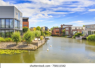 Villas and houses located at the water on a sunny Summer day. Located at the suburban Noordhove in the city Zoetermeer, the Netherlands.