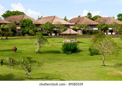 Villas and hut in green field of India