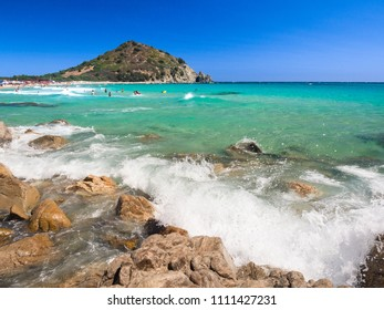 Villasimius, Italy - August 18, 2017: Transparent and turquoise sea in Cala Sinzias, Villasimius. Sardinia, Italy