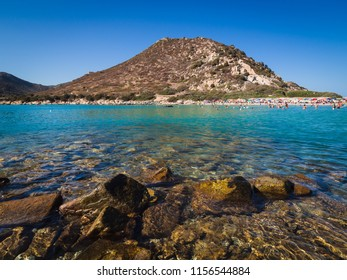 Villasimius, Italy - August 22, 2017: Transparent and turquoise sea in Punta Molentis, Villasimius. Sardinia, Italy