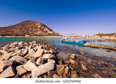 Villasimius, Italy - August 22, 2017: Transparent and turquoise sea in Punta Molentis, Villasimius. Sardinia, Italy