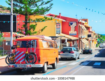 Villasimius, Italy - September 15, 2017: Old van with bicycles on road in Villasimius, Cagliary province, South Sardinia in Italy