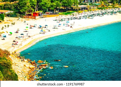 Villasimius, Italy - September 15, 2017: Shore of Beautiful Villasimius Beach at the Bay of the Blue Waters of the Mediterranean Sea in Sardinia Island in Italy in summer. Cagliari region.