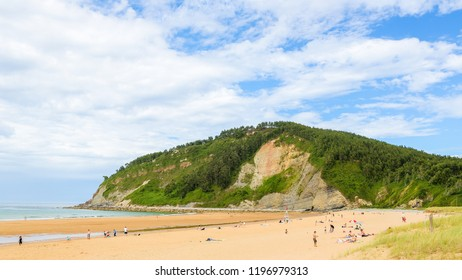 Villaviciosa, Spain - July 19, 2014: Beach at Villaviciosa, a town in Asturias, Spain, known as the most important municipality of Asturias in production of cider