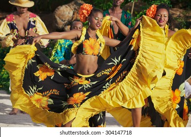 VILLE VALIO, MAURITIUS - NOVEMBER 29, 2012: Unidentified people wearing colorful dresses perform traditional creole Sega dance at sunset in Ville Valio, Mauritius.