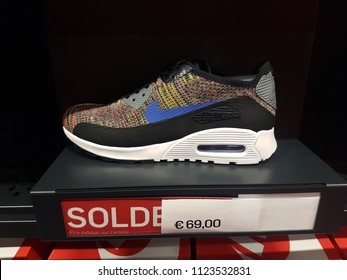 Villefontaine, France - July 29 2018: Multicolor Nike Air Max Shoe On Display in Nike Outlet Store at The Village Outlet Shopping, Sale Price Sign in French Language. Complex in Isere, France, Europe
