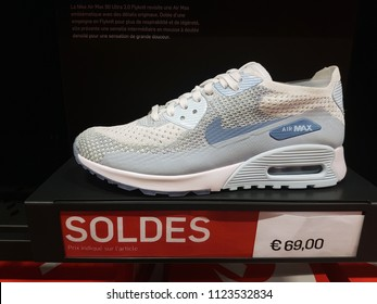 Villefontaine, France - July 29 2018: Nike Air Max Shoe On Display in Nike Outlet Store at The Village Outlet Shopping, Sale Price Sign in French Language. Complex in Isere, France, Europe